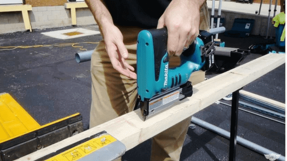 A guy using a pin nailer