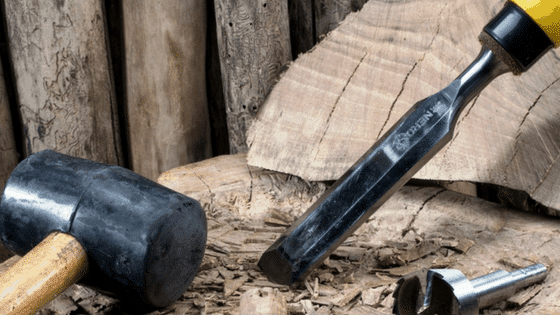 cutting wood with a chisel